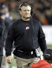 Utah football coach Kyle Whittingham walks the sideline during the first half of their NCAA college football game against Oregon State in Corvallis, Ore., Saturday, Oct. 20, 2012. (AP Photo/Don Ryan)