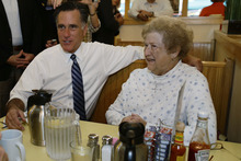 Republican presidential candidate and former Massachusetts Gov. Mitt Romney sits and talks to a customer as he makes an unscheduled stop at First Watch cafe in Cincinnati, Ohio, Thursday, Oct. 25, 2012. (AP Photo/Charles Dharapak)