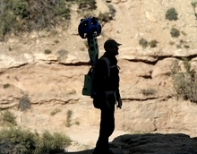 In this Monday Oct. 22, 2012 photo, Google operation manager Steve Silverman is silhouetted against a canyon wall as he poses with the Trekker during a demonstration for the media along the Bright Angel Trail at the South Rim of the Grand Canyon National Park in Arizona. The search engine giant is using the nearly 40-pound, backpack-sized camera unit to showcase the Grand Canyon's most popular hiking trails on the South Rim and other off-road sites. It's about 4 feet in height when set on the ground, and when worn, the camera system extends 2 feet above the operator's shoulders. (AP Photo/Rick Bowmer)