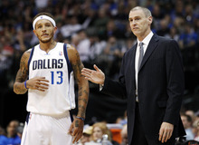 FILE - In this Oct. 17, 2012, file photo, Dallas Mavericks guard Delonte West (13) talks to head coach Rick Carlisle during a break in play against the Phoenix Suns in the first half of a preseason NBA basketball game in Dallas. The Mavericks suspended West Thursday, Oct. 25, for unspecified conduct detrimental to the team, his second such ban in the past 10 days. (AP Photo/Tony Gutierrez, File)