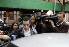 A man claiming to be the brother of New York City Police Officer Gilberto Valle is questioned by the media  Thursday, Oct. 25, 2012, in the Queens borough of New York. The o r was charged Thursday in a ghoulish plot to kidnap and torture women and then cook and eat their body parts.   (AP Photo/Frank Franklin II)
