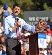 Republican vice presidential candidate Paul Ryan speaks to supporters during a rally at Universal Fiber Systems on Thursday, October 25, 2012 in Bristol, Va. Ryan spoke Thursday to about 1,500 supporters waving miniature American flags in Bristol before heading to Charlottesville for an evening campaign stop. He warned that Obama was trying to put in place tough regulations and higher taxes on coal, which would shut coal mines and hurt economies in Appalachia. (AP Photo/Bristol Herald Courier, Earl Neikirk)
