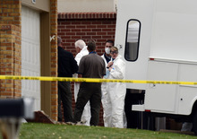 Forensic team members look for evidence as Westminster police serve a search warrant at the home of Austin Reed Sigg related to the kidnapping and murder of 10-year-old Jessica Ridgeway in Westminster, Colo., Wednesday, Oct. 24, 2012. Police in Westminster say a Tuesday phone call led them to the home of 17-year-old Sigg. Police took Sigg into custody Tuesday night and officially arrested him Wednesday Jessica's death and in a May attack on a 22-year-old woman. (AP Photo/The Denver Post, Joe Amon)