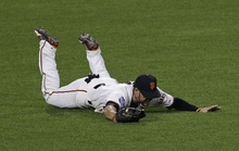 San Francisco Giants' Gregor Blanco dives to catch a ball hit by Detroit Tigers' Prince Fielder during the sixth inning of Game 1 of baseball's World Series Wednesday, Oct. 24, 2012, in San Francisco. (AP Photo/Jeff Chiu)