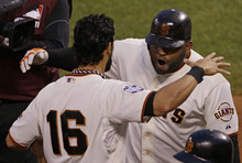 San Francisco Giants' Pablo Sandoval, right, celebrates with Angel Pagan after hitting a two-run home run during the third inning of Game 1 of baseball's World Series Wednesday, Oct. 24, 2012, in San Francisco. (AP Photo/Jeff Chiu)