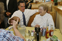 Republican presidential candidate and former Massachusetts Gov. Mitt Romney makes an unscheduled stop at First Watch cafe and greets patrons in Cincinnati, Ohio, Thursday, Oct. 25, 2012. (AP Photo/Charles Dharapak)