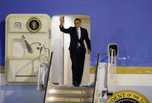 President Barack Obama arrives at McCarran International Airport for a campaign stop on Wednesday, Oct. 24, 2012, in Las Vegas. (AP Photo/Isaac Brekken)