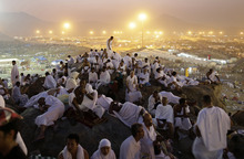 Muslim pilgrims pray on a rocky hill called the Mountain of Mercy, on the Plain of Arafat near the holy city of Mecca, Saudi Arabia, in the early hours of Thursday, Oct. 25, 2012. Saudi authorities say around 3.4 million pilgrims — some 1.7 million of them from abroad — have arrived in the holy cities of Mecca and Medina for this year's pilgrimage. (AP Photo/Hassan Ammar)