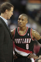 Portland Trail Blazers head coach Terry Stotts talks with rookie guard Damian Lillard during the third quarter against the Sacramento Kings in a NBA preseason basketball game in Sacramento, Calif, Monday, Oct. 15, 2012.  The Kings won 117-100.(AP Photo/Rich Pedroncelli)