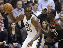 Portland Trail Blazers forward J.J. Hickson (21) defends Utah Jazz center Al Jefferson (25) during the first quarter of a preseason NBA basketball game Thursday, Oct. 25, 2012, in Salt Lake City. (AP Photo/Rick Bowmer)