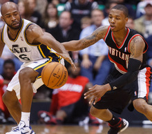 Trent Nelson  |  The Salt Lake Tribune Utah Jazz guard Jamaal Tinsley (6) defended by Portland's Damian Lillard (0) as the Utah Jazz host the Portland Trailblazers in preseason NBA basketball Thursday October 25, 2012 at EnergySolutions Arena in Salt Lake City, Utah.