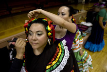 Kim Raff | The Salt Lake Tribune Sarahi Ponce has her makeup done before a rehearsal at a Salt Lake City LDS ward for a Latino cultural program to be held next week in Spanish at the Conference Center.