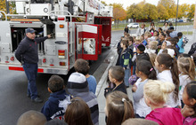 Al Hartmann  |  The Salt Lake Tribune A West Valley City Fire Department enigneer explains the workings of a fire engine to Whittier Elementary School first graders during a safety talk about the dangers of fire on Thursday.