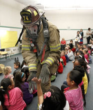 Al Hartmann  |  The Salt Lake Tribune A West Valley City firefighter gives