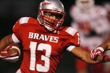 Kim Raff | The Salt Lake Tribune Bountiful High School player Jakob Hunt makes a run against East High at Bountiful High School in Bountiful, Utah on October 5, 2012.