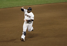 San Francisco Giants' Pablo Sandoval reacts after hitting a home run during the fifth inning of Game 1 of baseball's World Series against the Detroit Tigers Wednesday, Oct. 24, 2012, in San Francisco. (AP Photo/Jeff Chiu)