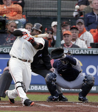 San Francisco Giants Pablo Sandoval hits a solo home run in the first inning during the first inning of Game 1 of baseball's World Series against the Detroit Tigers, Wednesday, Oct. 24, 2012, in San Francisco. (AP Photo/Charlie Riedel)
