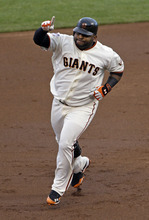San Francisco Giants' Pablo Sandoval reacts after hitting a home run during the first inning of Game 1 of baseball's World Series against the Detroit Tigers Wednesday, Oct. 24, 2012, in San Francisco. (AP Photo/Jeff Chiu)