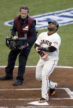 San Francisco Giants' Pablo Sandoval reacts after hitting a home run during the first inning of Game 1 of baseball's World Series against the Detroit Tigers Wednesday, Oct. 24, 2012, in San Francisco. (AP Photo/Eric Risberg)