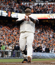 San Francisco Giants' Pablo Sandoval reacts after hitting a home run during the first inning of Game 1 of baseball's World Series against the Detroit Tigers Wednesday, Oct. 24, 2012, in San Francisco. (AP Photo/David J. Phillip)