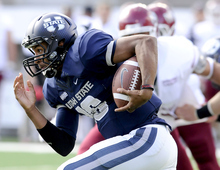 Utah State quarterback Chuckie Keeton (16) carries the ball for a 76-yard touchdown against New Mexico State during an NCAA college football game on Saturday, Oct. 20, 2012, in Logan, Utah. (AP Photo/The Herald Journal, Eli Lucero)