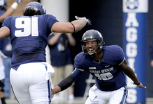 Utah State quarterback Chuckie Keeton (16) celebrates with tight end D.J. Tialavea (91) after throwing a 76-yard touchdown pass during an NCAA college football game against New Mexico State, Saturday, Oct. 20, 2012, in Logan, Utah. (AP Photo/The Herald Journal, Eli Lucero)