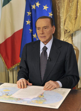 In this photo released by the Berlusconi press office Thursday, Oct. 25, 2012, former Italian premier Silvio Berlusconi tapes a video message where he announces he will not run for a fourth term as premier in spring elections. Berlusconi has until now been coy about his intentions. But the three-time former premier posted a statement on his movement's website yesterday, under the headline: