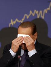 FILE - In this Sept. 27, 2012 file photo, Italian former premier Silvio Berlusconi wipes his forehead during a press conference in Rome, Italy. A court in Italy has convicted, Friday, Oct. 26, 2012, former Premier Silvio Berlusconi of tax fraud and sentenced him to four years in prison. In Italy, cases must pass two levels of appeal before the verdicts are final. Berlusconi is expected to appeal. (AP Photo/Alessandra Tarantino, File)