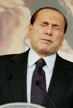 FILE - In this Feb. 9, 2011 file photo, Italian former premier Silvio Berlusconi grimaces during a press conference in Rome, Italy. A court in Italy has convicted, Friday, Oct. 26, 2012, former Premier Silvio Berlusconi of tax fraud and sentenced him to four years in prison. In Italy, cases must pass two levels of appeal before the verdicts are final. Berlusconi is expected to appeal. (AP Photo/Pier Paolo Cito, File)