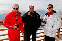 File- In this Thursday, March 8, 2012 file photo, then Russian Prime Minister Vladimir Putin, left, former Italian Prime Minister Silvio Berlusconi, center, and then Russian President Dmitry Medvedev, right, smile during their meeting in the mountain resort of Krasnaya Polyana near the Black Sea resort of Sochi, southern Russia. A court in Italy has convicted former Premier Silvio Berlusconi of tax fraud and sentenced him to four-years in prison. Berlusconi is expected to appeal. (AP Photo/RIA-Novosti, Dmitry Astakhov, Presidential Press Service)