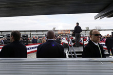 U.S. Secret Service agents stand watch as Republican presidential candidate, former Massachusetts Gov. Mitt Romney speaks about the economy at a campaign rally at Kinzler Construction Services in Ames, Iowa, Friday, Oct. 26, 2012. (AP Photo/Charles Dharapak)