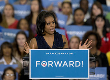 First Lady Michelle Obama speaks to a crowd during a campaign rally, Friday, Oct. 26, 2012, in Las Vegas. (AP Photo/Julie Jacobson)