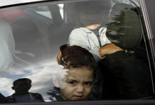 Bushr Al Tawashi is seen through a car window, outside of a private Sigma TV station, in Nicosia, Cyprus, Friday, Oct. 26, 2012. A 2-year-old Syrian boy who was believed dead after his family inadvertently left him behind as they fled shelling in Damascus last summer has been reunited with his parents in Cyprus, a lawyer said.