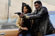 This film image released by Warner Bros. Pictures shows Halle Berry, left, and Keith David in a scene from