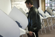 Chris Detrick  |  The Salt Lake Tribune Ryan Robinson, of Magna, votes early at the Salt Lake County Government Center on Tuesday. Early voting runs through Nov. 2 -- including limited Saturday hours at Salt Lake County offices. Election Day is Nov. 6.