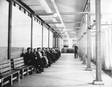 Recruits await interviews in private booths at the reception center at Fort Douglas during World War II. The fort, 150 years old this week, has never again been as busy as it was during that war. Photo courtesy of Fort Douglas Museum.