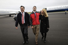 Republican presidential candidate and former Massachusetts Gov. Mitt Romney and his vice presidential running mate, Rep. Paul Ryan, R-Wis., and his wife, Janna, walk together from their campaign planes at Akron-Canton Regional Airport in Akron, Ohio, Friday, Oct. 26, 2012. Ryan met Romney on the tarmac after his plane landed at the airport. (AP Photo/Charles Dharapak)
