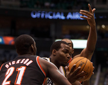 Trent Nelson  |  The Salt Lake Tribune Utah Jazz forward Paul Millsap (24) drives to the basket, with Portland's JJ Hickson (21) defending as the Utah Jazz host the Portland Trailblazers in preseason NBA basketball Thursday October 25, 2012 at EnergySolutions Arena in Salt Lake City, Utah.