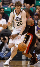 Trent Nelson  |  The Salt Lake Tribune Utah Jazz forward Gordon Hayward (20) collides with Portland's Damian Lillard (0) after stealing the ball as the Utah Jazz host the Portland Trailblazers in preseason NBA basketball Thursday October 25, 2012 at EnergySolutions Arena in Salt Lake City, Utah.