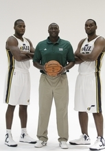 Utah Jazz head coach Tyrone Corbin, center, Utah Jazz's Paul Milsap, left, and teammate Al Jefferson, right, and pose for a photograph during Jazz media day Monday, Oct. 1, 2012, in Salt Lake. (AP Photo/Rick Bowmer)