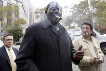 Former New York Giants linebacker Lawrence Taylor smokes a cigar as he leaves federal court, Friday, Oct. 26, 2012, in New York. Taylor won a lawsuit that tried to hold him accountable for having sex with a 16-year-old girl in a New York-area hotel room. The NFL Hall of Famer acknowledged that he had sex in 2010 with a prostitute. He denied, however, that he ignored obvious signs she was a teen runaway in distress. (AP Photo/Mary Altaffer)