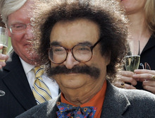 FILE - In this May 31, 2006 file photo, film critic Gene Shalit is seen during a toast with