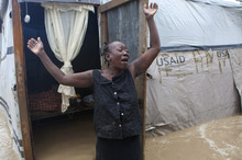 A woman cries out in front of her flooded house caused by heavy rains from Hurricane Sandy in Port-au-Prince, Haiti, Thursday, Oct. 25, 2012. Hurricane Sandy rumbled across mountainous eastern Cuba and headed toward the Bahamas on Thursday as a Category 2 storm, bringing heavy rains and blistering winds.  (AP Photo/Dieu Nalio Chery)