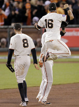 San Francisco Giants' Angel Pagan leaps up to celebrate with Brandon Crawford and Hunter Pence (8) after the Giants beat the Detroit Tigers 2-0 in Game 2 of baseball's World Series Thursday, Oct. 25, 2012, in San Francisco. (AP Photo/Charlie Riedel)