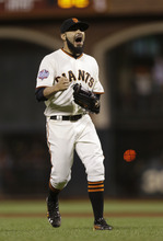 San Francisco Giants' Sergio Romo reacts after the Giants defeated the Detroit Tigers, 2-0, in Game 2 of baseball's World Series Thursday, Oct. 25, 2012, in San Francisco. (AP Photo/Marcio Jose Sanchez)