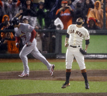San Francisco Giants relief pitcher Sergio Romo reacts after St. Louis Cardinals' Matt Holliday flies out to end Game 7 of baseball's National League championship series against the St. Louis Cardinals Monday, Oct. 22, 2012, in San Francisco. The Giants won 9-0 to win the series. (AP Photo/Mark Humphrey)