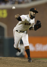 San Francisco Giants' Sergio Romo throws during the ninth inning of Game 2 of baseball's World Series against the Detroit Tigers Thursday, Oct. 25, 2012, in San Francisco. (AP Photo/Marcio Jose Sanchez)