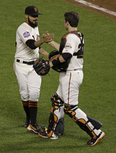 San Francisco Giants' Sergio Romo is congratulated by catcher Buster Posey after the Giants defeated the Detroit Tigers, 2-0, in Game 2 of baseball's World Series Thursday, Oct. 25, 2012, in San Francisco. (AP Photo/Jeff Chiu)