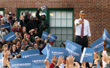 President Barack Obama waves to supporters as he arrives for a campaign event at Elm Street Middle School, Saturday, Oct. 27, 2012 in Nashua, N.H. (AP Photo/Jim Cole)