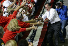 Republican presidential candidate and former Massachusetts Gov. Mitt Romney greets supporters as he campaigns at the Pensacola Civic Center in Pensacola, Fla., Saturday, Oct. 27, 2012. (AP Photo/Charles Dharapak)